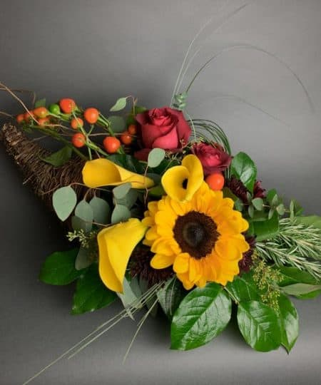 An arrangement so unique and lovely, this lush autumn cornucopia is styled with premium blooms and foliage